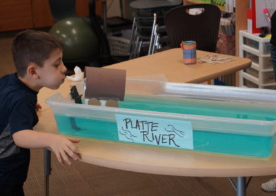 This students acts as the wind as he sets off his wagon!