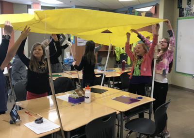 These students transformed desks into a covered wagon