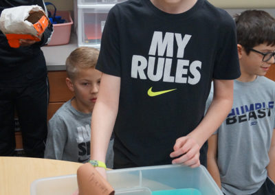 A student sets his egg cargo afloat