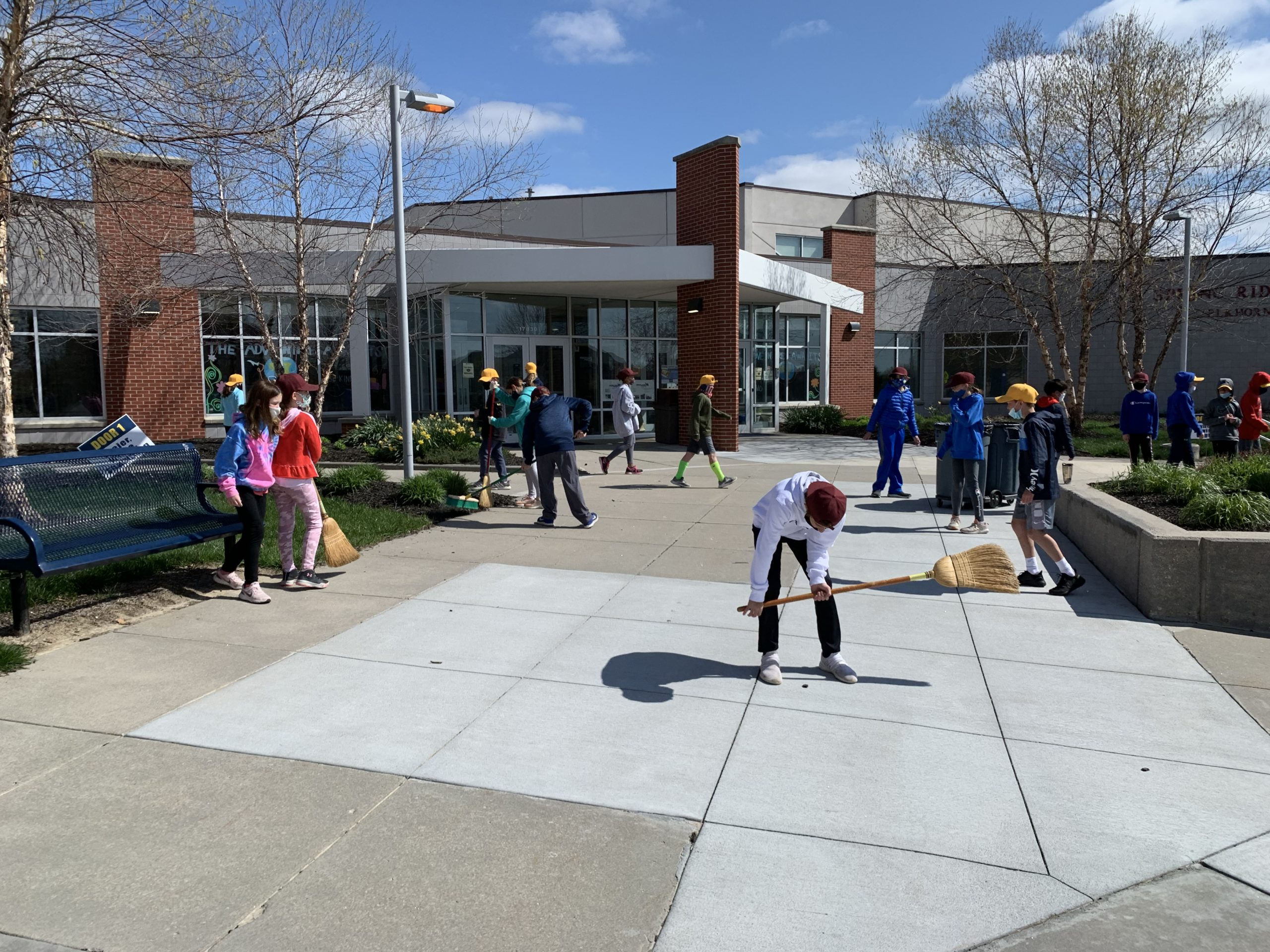 Students cleaning up school grounds